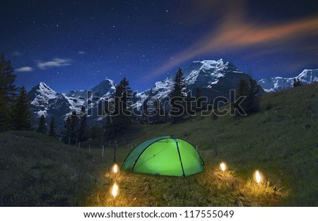 Camping in the Swiss Alps - stock photo