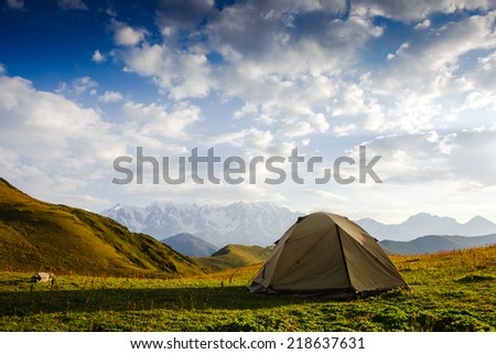 Camping in the wilderness at sunrise  - stock photo