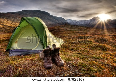 Camping in the wilderness of Norway at sunrise - stock photo