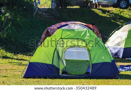 Camping in the wilderness, tent on campground in morning - stock photo