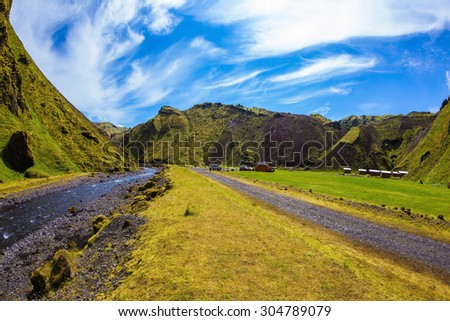 Camping in valley of canyon Pakgil. The canyon flowing fast shallow creek. Summer blooming Iceland. The photo was taken Fisheye lens - stock photo