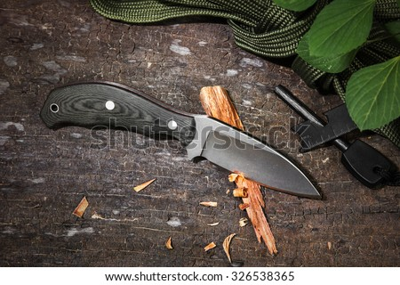 Camping knife. - stock photo