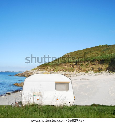 Camping mobile on a sandy ocean beach - stock photo