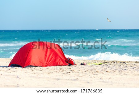 camping on sandy beach - stock photo