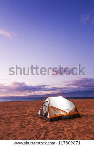 Camping on the Beach at Sunset - stock photo