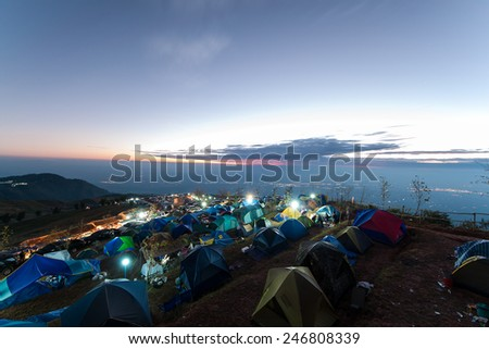Camping on the big mountain in Phu Tub berk of Thailand as tourist style with sunrise sky - stock photo