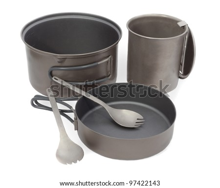Camping Pot, Spork, Cup and Frying Pan Cookware for Mountain Camping, Titanium Metal - stock photo