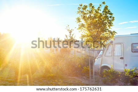 Camping site in the bright morning sunight - stock photo