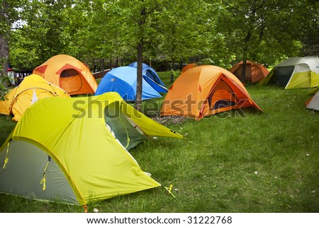 Camping sites with multi-colored tents - stock photo