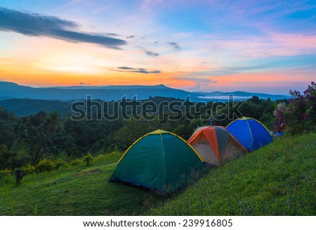 Camping tent in campground at national park with sunrise. - stock photo