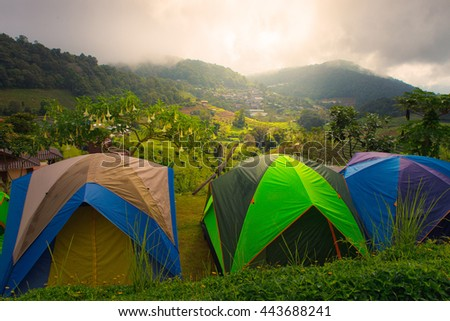 Camping tent in campground at national park with sunrise - stock photo