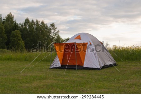 Camping tent in nature in summertime - stock photo