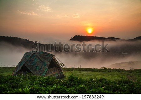 Camping tent with sunshine - stock photo