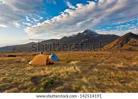 Camping tents on Kamchatka valley, Russia. - stock photo