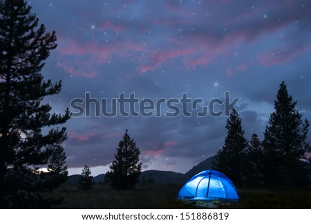 Camping under a summer night sky - stock photo