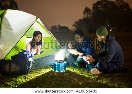 Camping with friends - stock photo