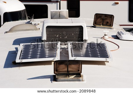 Camping with solar panels for converting energy from the sun to electricity. - stock photo