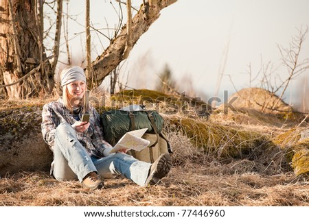 Camping young woman search navigation compass map in countryside - stock photo
