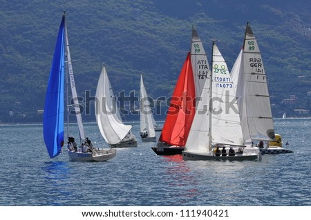 CAMPIONE DEL GARDA (BS) ITALY - SEPTEMBER 2: Sailing boats pass a buoy during the Trofeo Gorla regatta, on September 2, 2012 in Campione del Garda (BS)