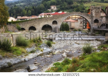 CAMPRODON, CATALONIA/SPAIN - autumn, 2015: New Bridge over Ter River in the small town of Camprodon, located in the Pyrenees. simulating a filter instagram - stock photo