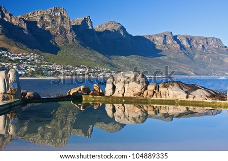 camps bay south africa rock pools with a view of the mountains - stock photo