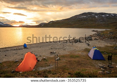 Campside on a mountian lake in Sweden at Sunset - stock photo
