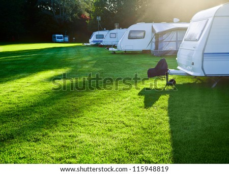 Campsite with caravans in a morning light - stock photo