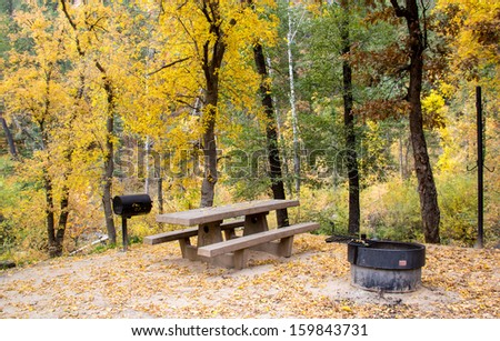 campsite with picnic bench in Sedona Arizona with fall colors on trees