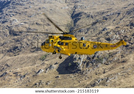 Camusrory, Scottish Highlands, UK - MAY 1: RAF Sea King helicopter XZ589 passing by Sourlies bothy on May 1, 2012 at Camusrory, Western Highlands. - stock photo