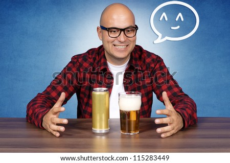 Can and glass in beer lover hands - stock photo