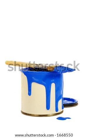 can of blue paint with paint spilling over edge and brush on top of can - stock photo