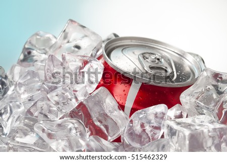 Can of soda pop in ice showing cold refreshing drink in the summer