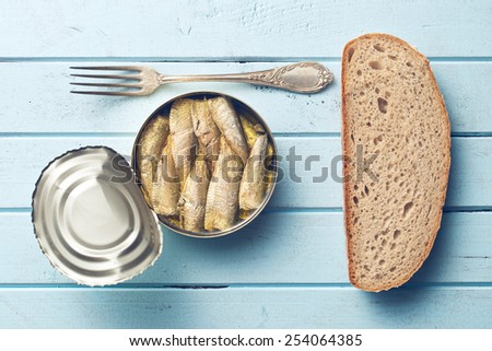 can of sprats and bread - stock photo