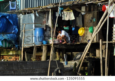 CAN THO - FEB 17: Typical shack home along the Mekong Delta. People from the slum area are living in poverty with a low standard of living and hygienic conditions. On Feb 17, 2013 in Can Tho, Vietnam