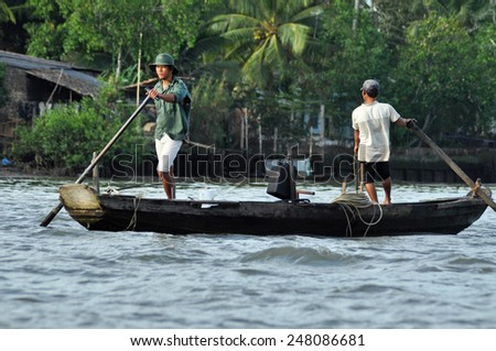CAN THO - FEB 17: Unidentified Vietnamese fishermen fishing in the Mekong delta. After the Ganges delta, Mekong delta is the second biggest delta in the world. On Feb 17, 2013 in Cai Rang, Vietnam - stock photo