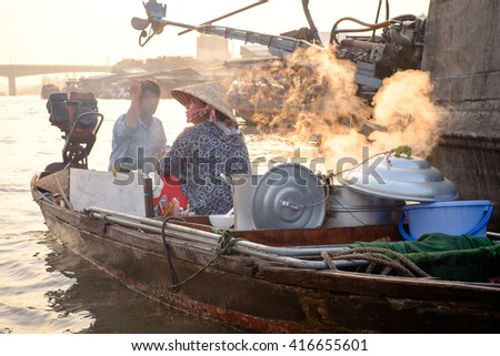 Can Tho, Vietnam - April 2, 2016: Boat cafe on Cai Rang floating market in the Mekong Delta river at sunset time