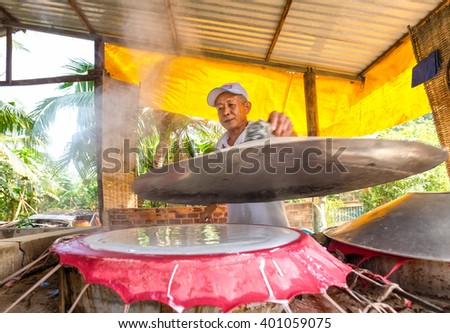 Can Tho, Vietnam - February 4th, 2016: workers are coated lid oven bread in the oven manufacturing noodles noodles in the morning, this is the specialty of the countryside Can Tho, Vietnam
