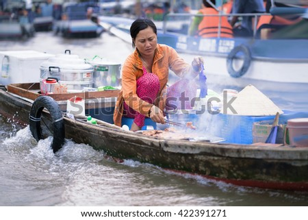 Can Tho, Vietnam - February 28, 2016: Woman cooking food for sale in the floating market in Can Tho in Vietnam.
