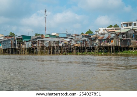 CAN THO, VIETNAM - JANUARY 26: Run down houses on the bank of Mekong river on January 26, 2014 in Can Tho, Vietnam. - stock photo