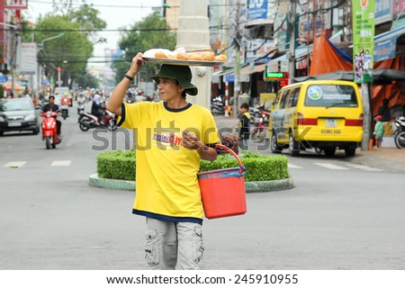 Can Tho, Vietnam. June 14, 2014 : Unidentified street hawker selling bread at Can Tho, Vietnam on June 14, 2014.Mobile street hawker selling food is common across city in Vietnam.