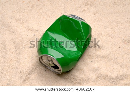 Can tossed on the sand - stock photo