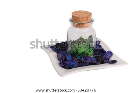 Can with flowers petal isolated on white - stock photo