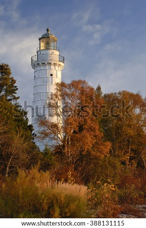 Cana Island Light seems lit by the autumn morning light, while in reality the still active light turns off just prior to sunrise, Door County, Wisconsin - stock photo