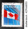 CANADA - 1995: A stamp printed in Canada worth $0.45 shows image of a the Canadian flag and a modern building, series, 1995 - stock photo