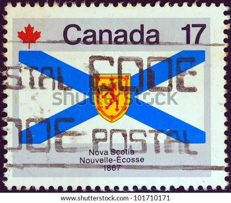"""CANADA - CIRCA 1979: A stamp printed in Canada from the """"Canada Day. Flags"""" issue shows Nova Scotia flag, circa 1979. - stock photo"""