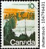 CANADA - CIRCA 1972: A stamp printed in Canada shows a forest, central Canada, circa 1972. - stock photo