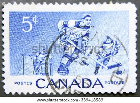 CANADA - CIRCA 1956: A stamp printed in Canada shows ice hockey, circa 1956 - stock photo