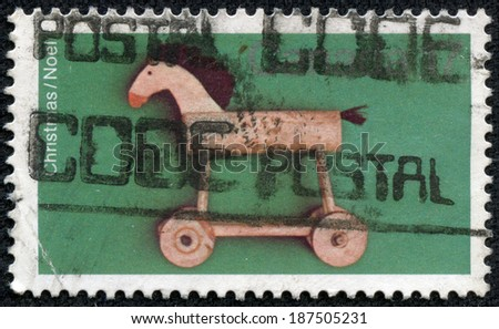 CANADA - CIRCA 1981: A stamp printed in Canada shows image of a child's toy horse, series, circa 1981 - stock photo