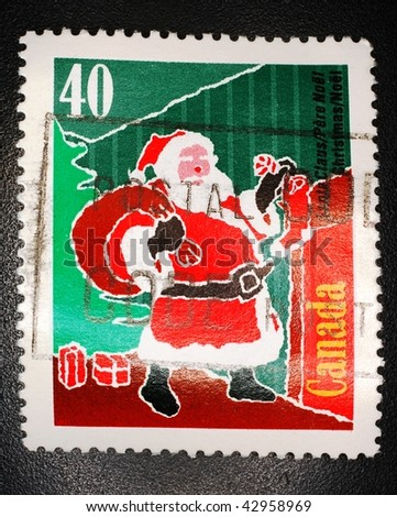 CANADA - CIRCA 2004: A stamp printed in Canada shows image of Santa Claus, series, circa 2004 - stock photo