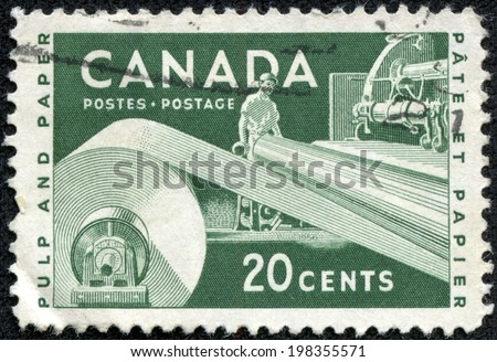 CANADA - CIRCA 1953: A stamp printed in Canada shows machine tool for manufacture of paper, devoted Pulp and Paper Industry, circa 1953